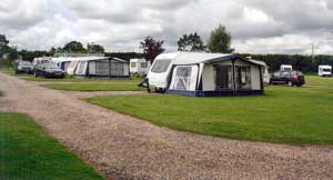 Caravans with tented awning - Greenarces Touring Park