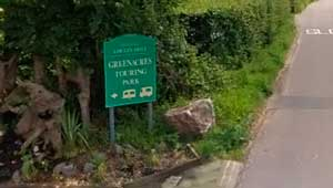 Greeanarces Touring Park Sign by Entrance